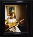 《ギターを弾く女》