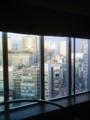 ビルに映る朝日 from 新宿バルト9