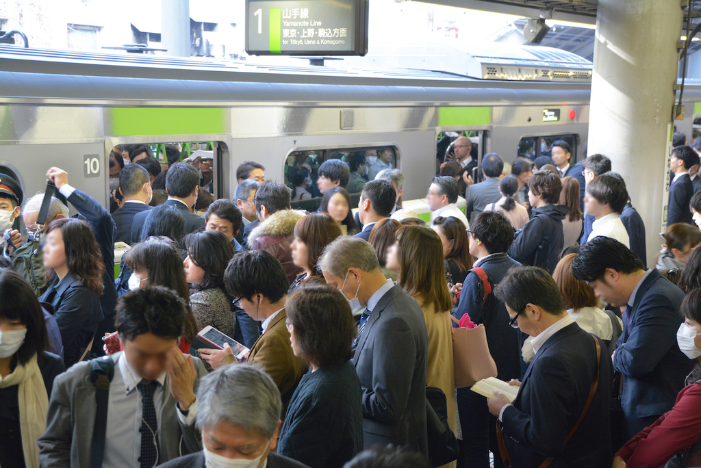 A packed platform during rush hour in Tokyo on the Yamanote Line.