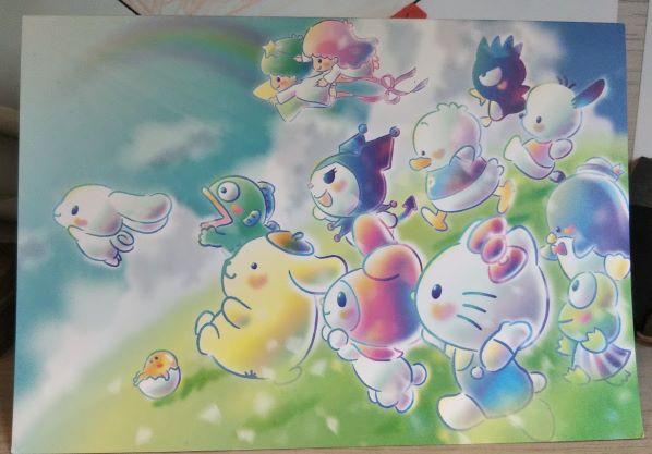 サンリオのキャラクターたちがみんなで前を向いている絵が描かれているカード