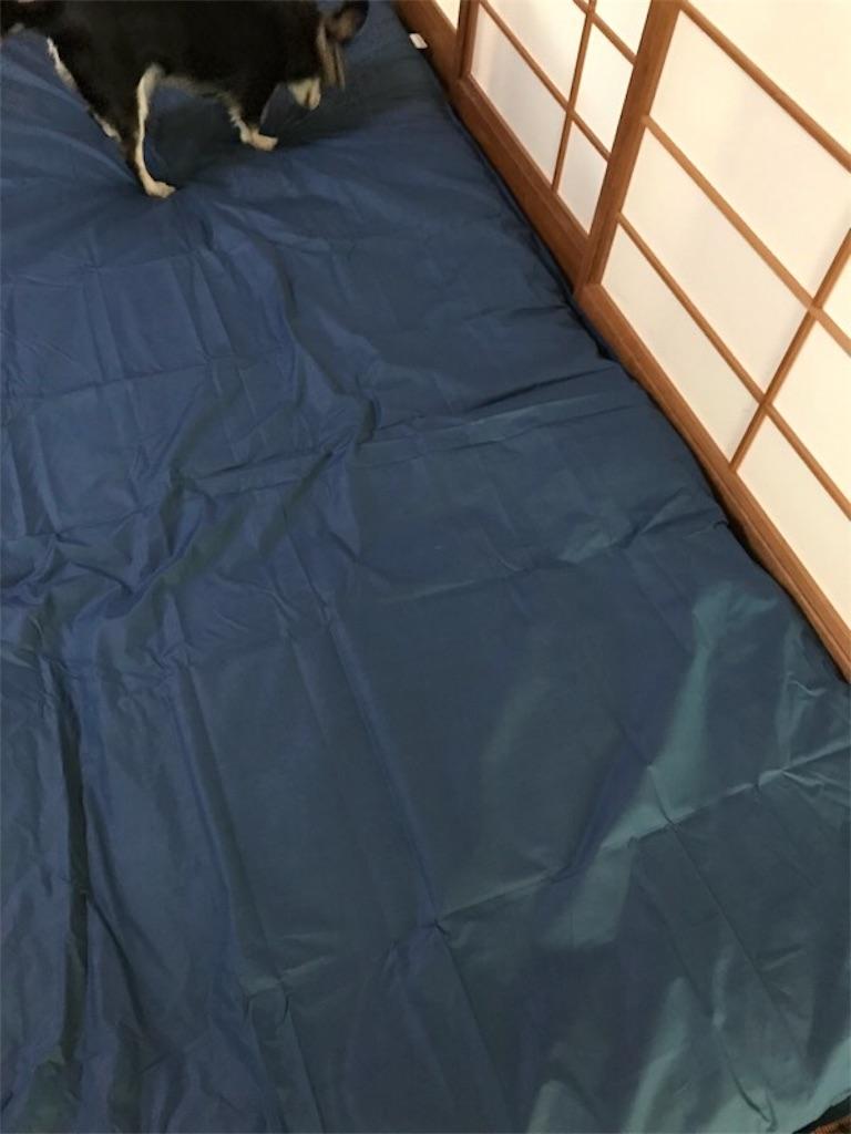 和室に敷き布団を敷く