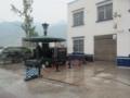 交通機動隊の検問所,ず~と携帯で遊んでいる(中国重慶市奉節県江南郷)