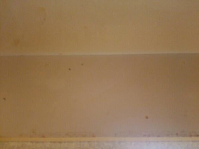 油で汚れたキッチンの天井画像