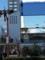 京都駅の駅ビルの窓に映る京都タワー