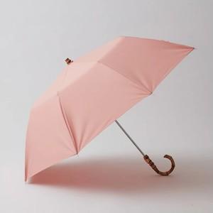ピンクの折り畳み傘