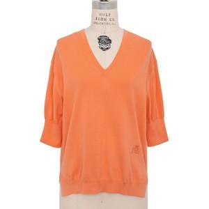 オレンジの半袖ニット