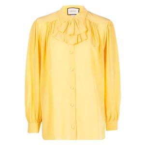 黄色いブラウス