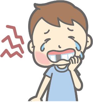 歯が痛い男の子