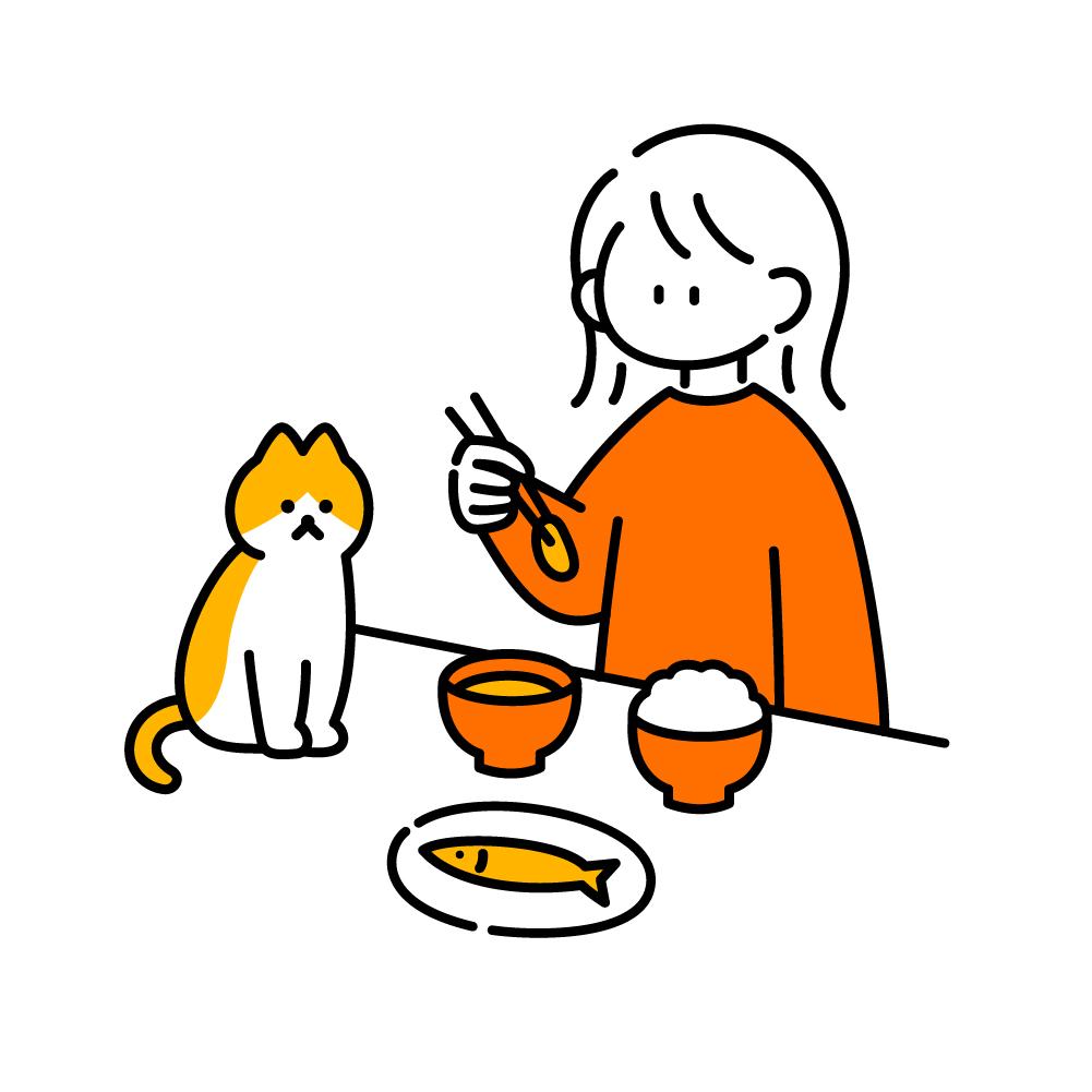 猫と一緒に食事する女の子
