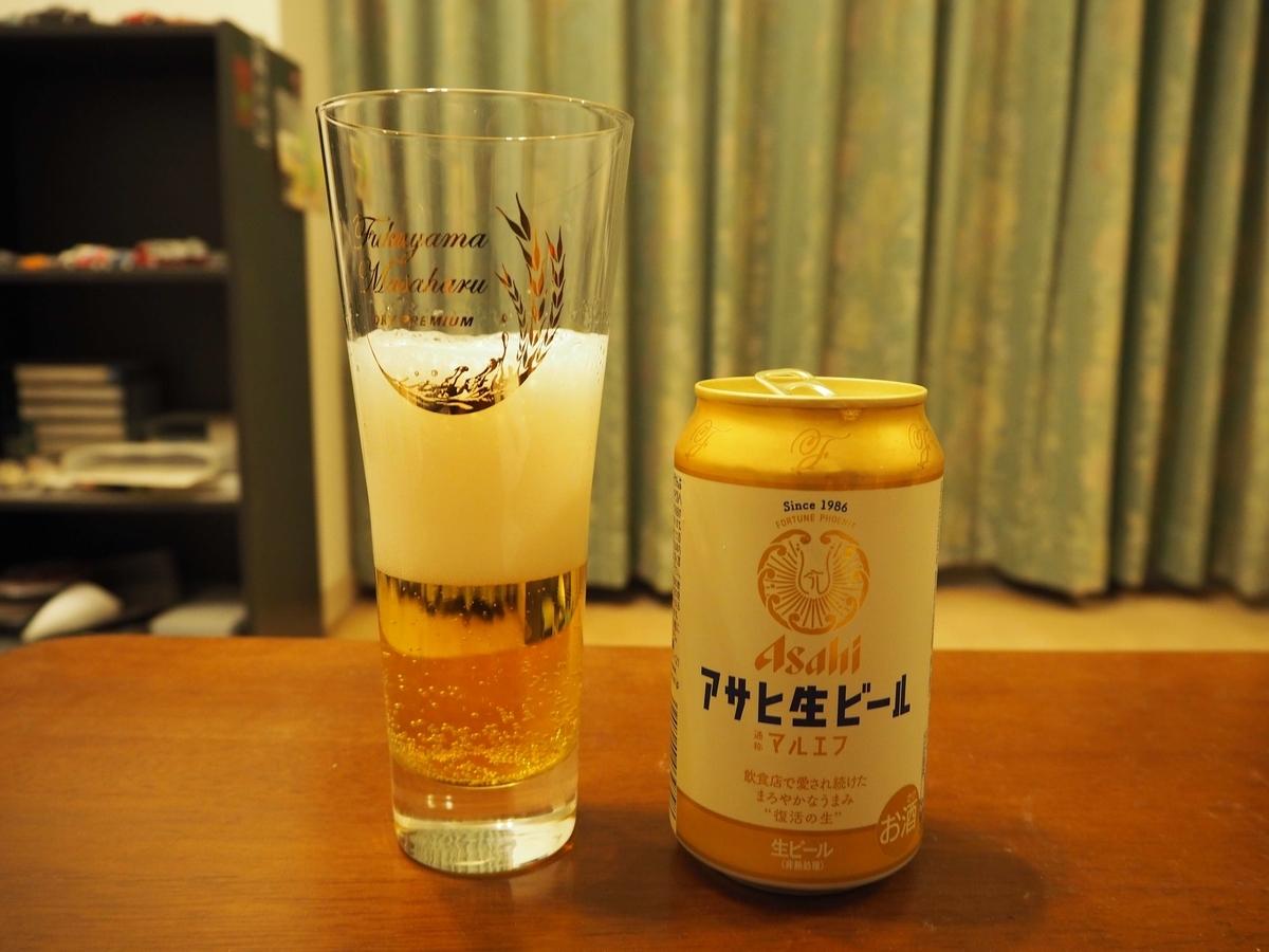 泡が落ち着いたアサヒ生ビール