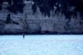 パドルサーフィン岩へと向かう
