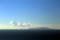 伊豆大島と左へ向かう龍のような雲