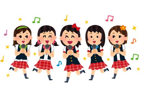 楽しそうに歌って踊っているアイドルグループ