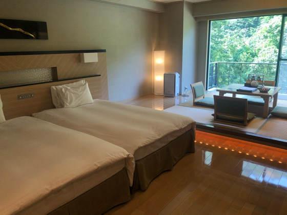 箱根にあるホテルはつはなのスタンダード和洋室のベッド