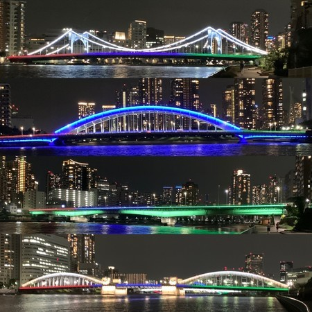 The Sumida River bridge lit up in the colors of the Olympics.
