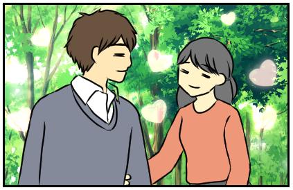 彼の腕に手をまわしている彼女