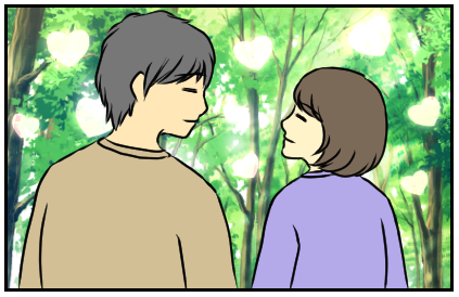 見つめ合って手をつないでいる彼氏と彼女