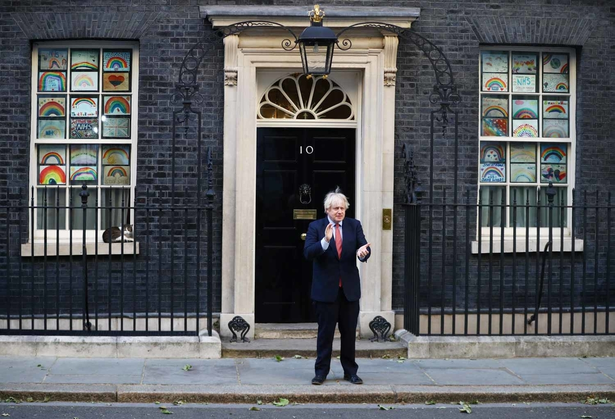 Britain's Prime Minister Boris Johnson applauds outside 10 Downing Street during the last day of the Clap for our Carers campaign in support of the NHS, following the outbreak of the coronavirus disease (COVID-19), in London, Britain, May 28, 2020.