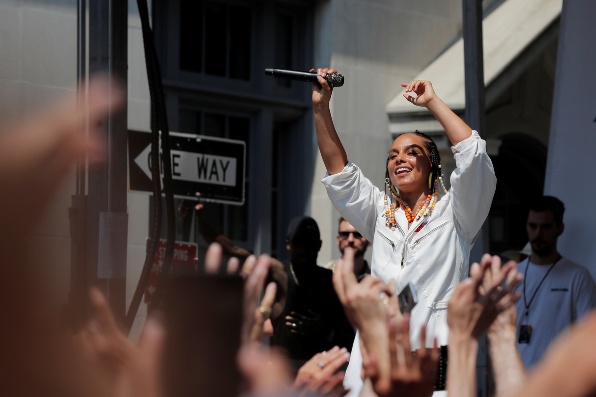 Alicia Keys performs outside of the Stonewall Inn to celebrate the 50th anniversary of the Stonewall uprising in New York
