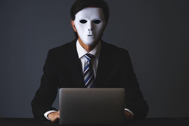 仮面をかぶったビジネスマン