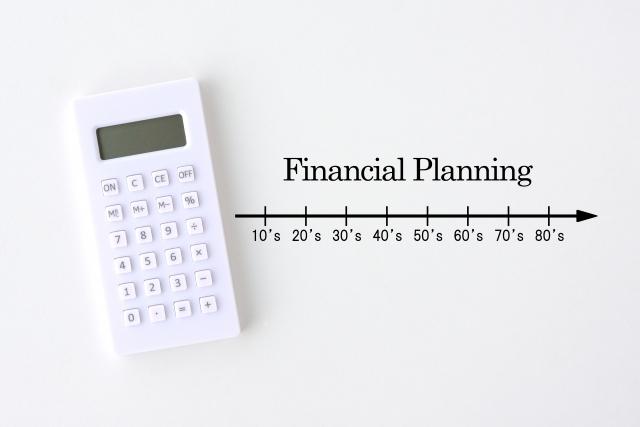 電卓とFinancial Planningの画像