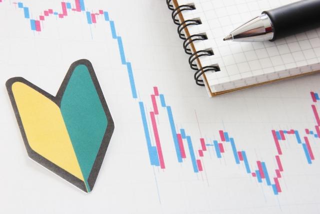 若葉マークと株価のチャートの画像
