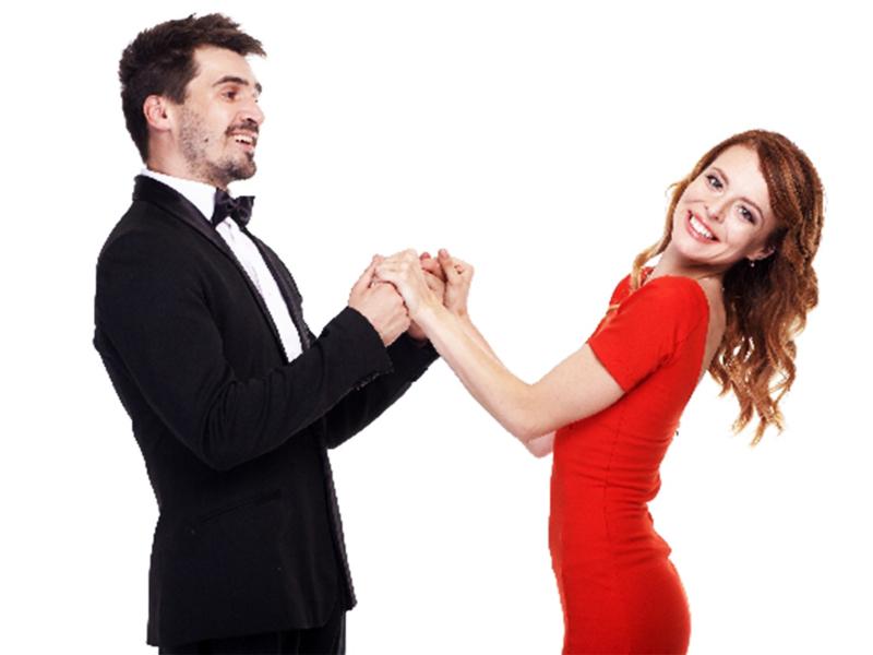 手を取り踊る男女
