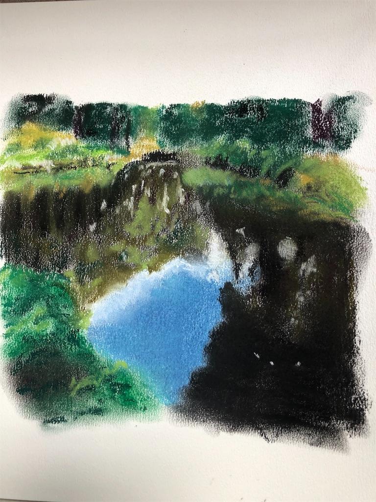 池にうつる空