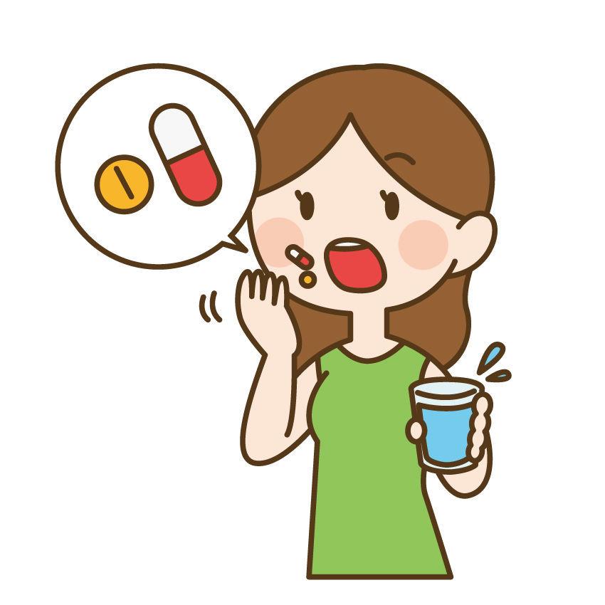 生理痛の薬を飲む