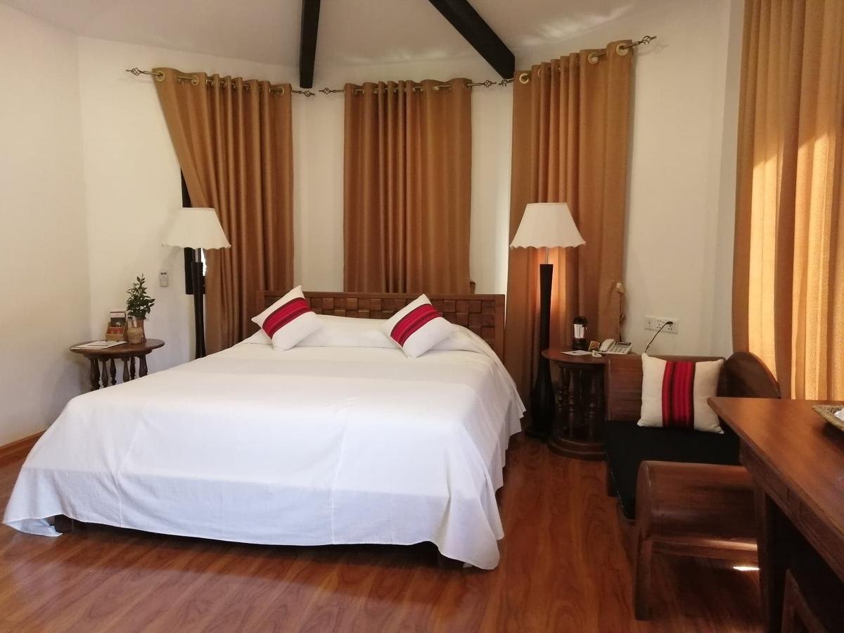 ダブルベッドがある部屋の写真