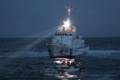 東日本大震災の被災地で活動する海上保安官