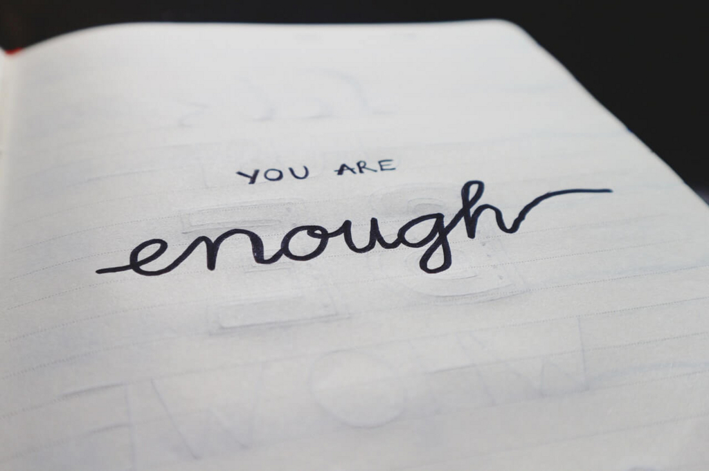 """you are enough""と書かれた写真"