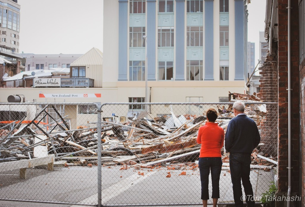 couple were watching rubble of a building