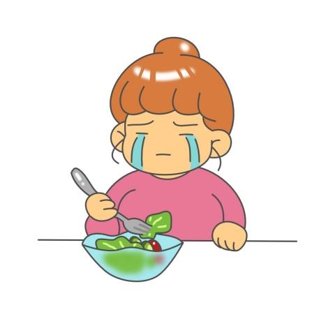 食べ物を我慢する女性