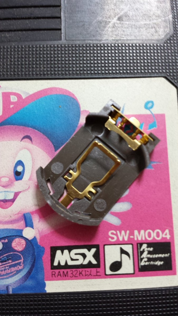 FM-PACの電池を電池ホルダーに交...