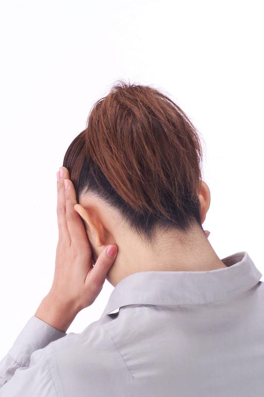顎関節症の女性