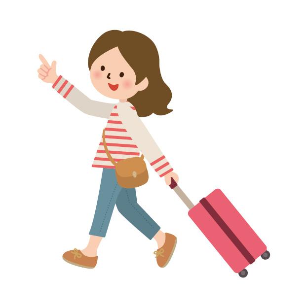 スーツケースを持っている女性