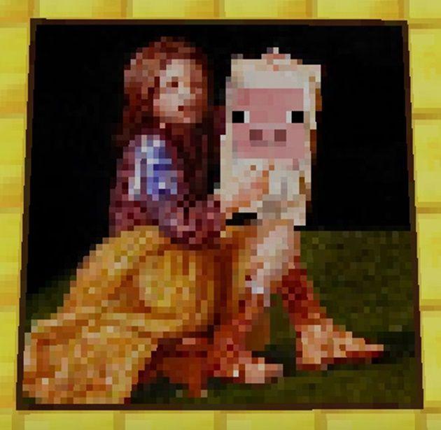 豚を抱く少女