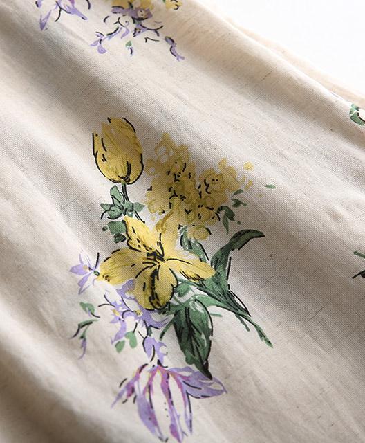 水彩の花を咲かせるリネン混のノースリブラウス