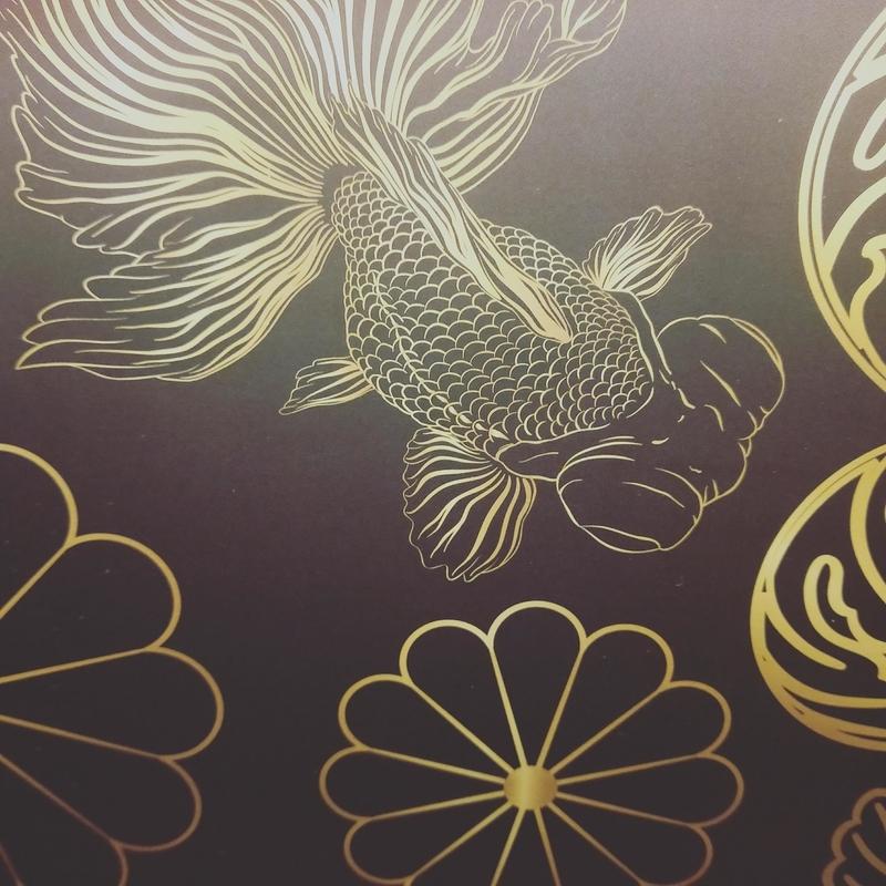 アートアクアリウムの展示の装飾に描かれる金魚