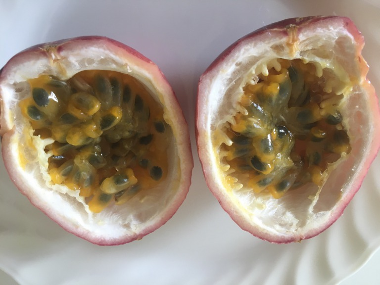 Light red passion fruit cut in half