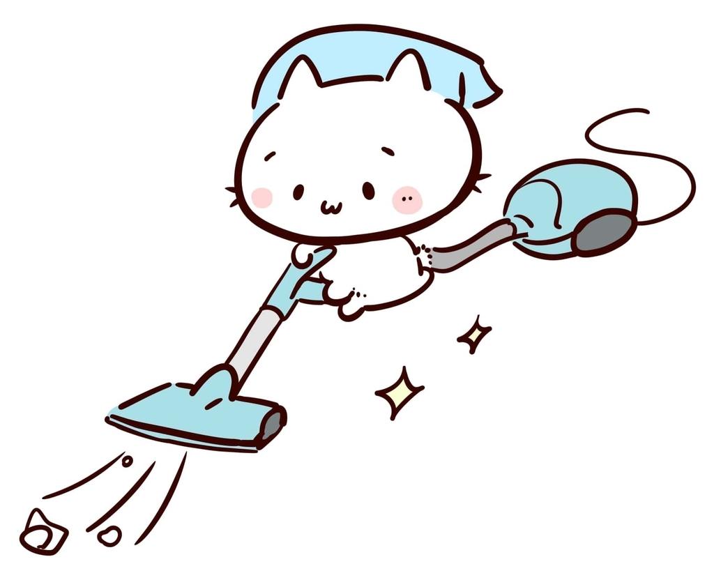 猫が掃除機の写真