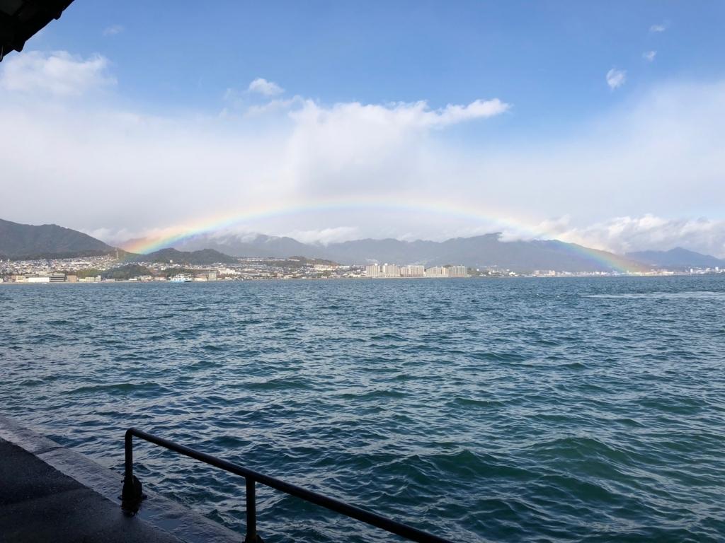 広島県 宮島桟橋 海にかかる虹