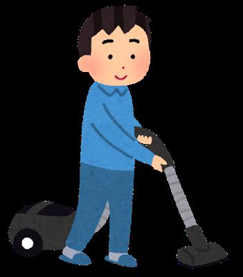 掃除機をかけている男性