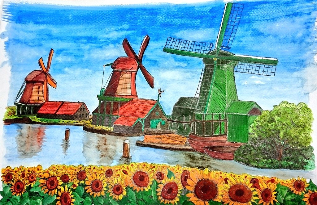オランダを意識したオレンジと緑の風車。そっとヒマワリを添えて。