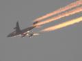 飛行機雲 夕焼け