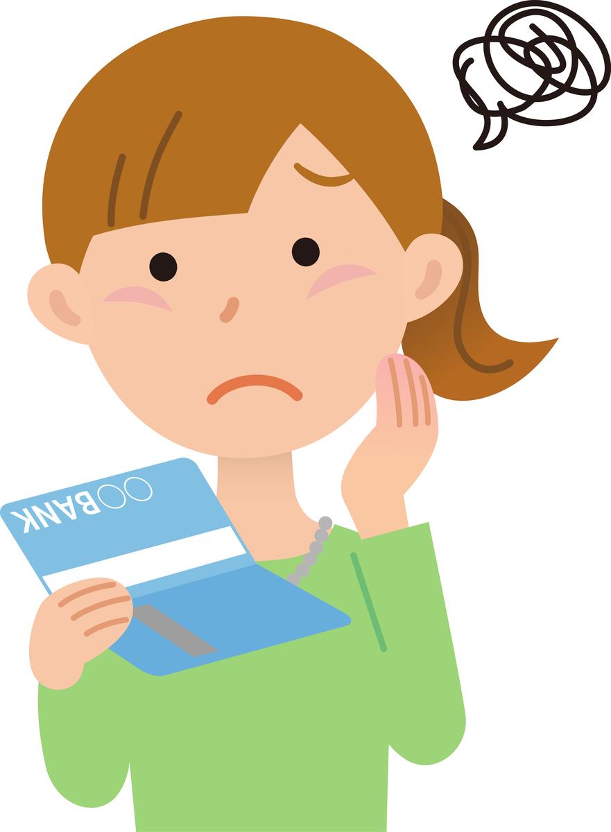 通帳を憂鬱な表情で眺める女性