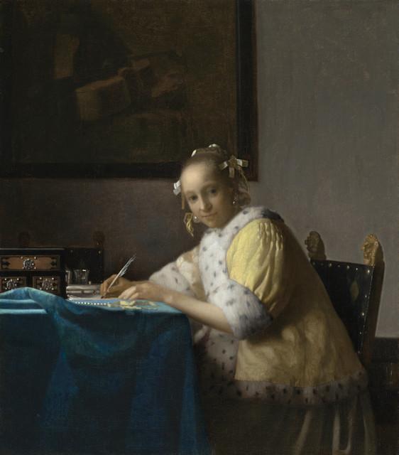 手紙を書く女
