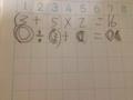 息子が書いてきたお皿の計算式なんか違うような~と言うと