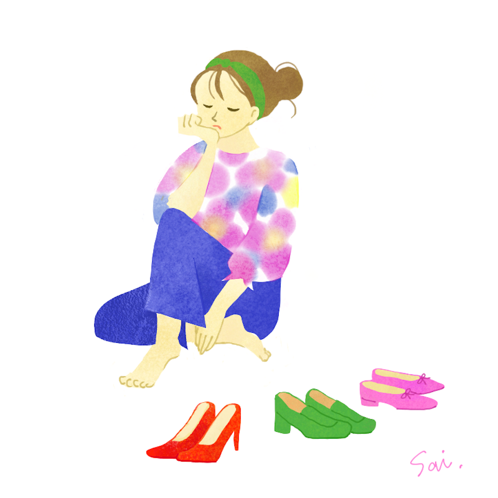 靴を選ぶ女性